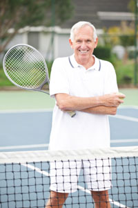 elderly man holding tennis racket