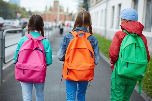 Three children with backpacks