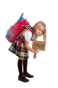 girl with heavy backpack