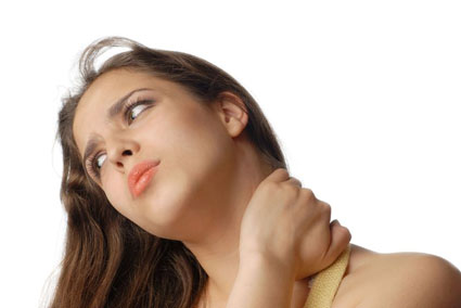 young woman holding neck due to pain