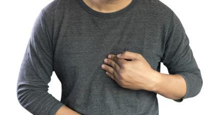 man touching chest